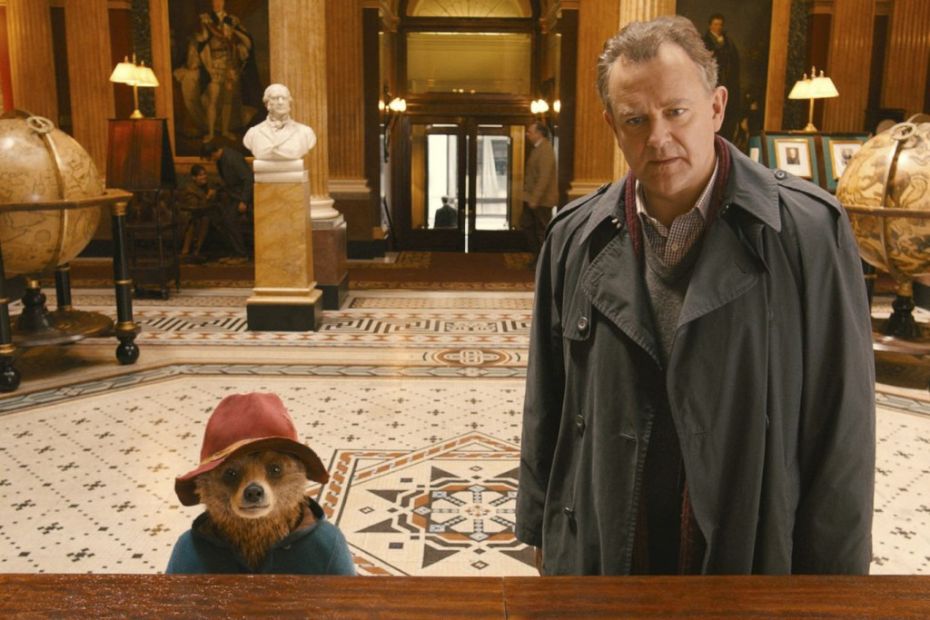 Hugh Bonneville as Henry Brown with Paddington bear.