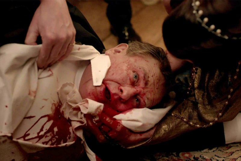 Lord Grantham vomits blood over the dinner table after suffering from a burst ulcer in a scene from Downton Abbey